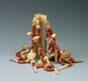 Jade and agate ensemble, clasped in the hand of deceased lady